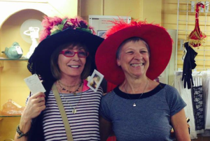 Kathy (left) Antonelli and Jan Couper checking out hats